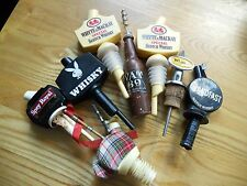 A collection of Whisky pourers and a VAT 69 bottle opener