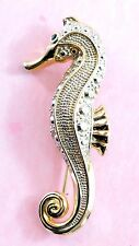 Vintage attractive gold plated & silver tone seahorse brooch - glass crystal eye