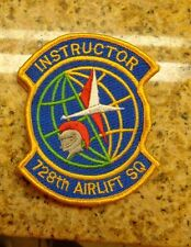 USAF FLIGHT SUIT PATCH,728TH AIRLIFT SQUADRON,INSTRUCTOR,W/ VELCR,GOLD LETTERS