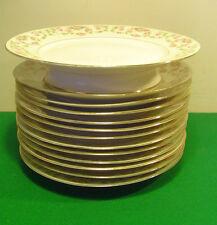 12 assiettes plates et un compotier en Porcelaine de Limoges à fleurettes roses
