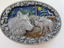 Wolf pack belt buckle howling wolf  and moon.