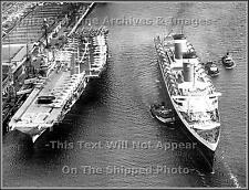 Photo: SS United States Passes Aircraft Carrier USS Shangri-La After Korean War
