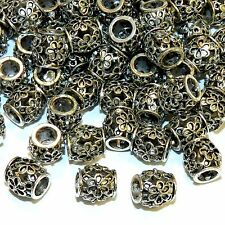 MBXL7273L2 Antiqued Silver Open Flower 9x11mm Lg Hole Oval Drum Metal Bead 50/pk