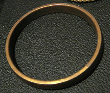 Lovely bangle style bracelet with bronze tone metal and brown decoration