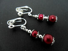 A PAIR OF DARK RED  GLASS PEARL AND SILVER  PLATED CLIP ON EARRINGS.