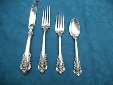 used Grand Baroque sterling silver 8-4 piece place settings by Wallace like new