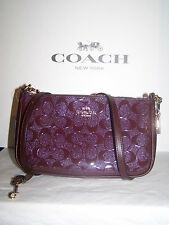 Coach F56518  NWT $225 Small Debossed hand crossbody bag Oxblood Patent Leather