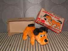 CRAGSTAN MECHANICAL (CLOCKWORK) SNIFFING DOG BY NOMURA. PERFECTLY WORKING IN BOX