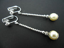 A PAIR OF LOVELY  SILVER PLATED IVORY PEARL DROP CLIP ON EARRINGS. NEW.