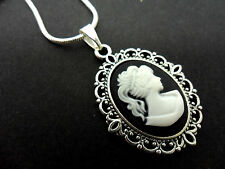 A PRETTY SILVER PLATED BLACK/WHITE CAMEO  PENDANT NECKLACE . NEW.