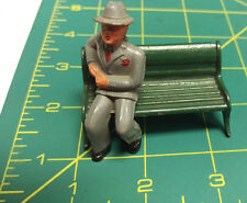 Vintage metal toy pieces Man in grey suit sitting on green bench - Man on bench