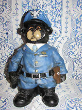 """BLACK BEAR IN A  BLUE POLICEMAN UNIFORM WITH CAP 15 1/2 """" TALL MADE OF RESIN"""