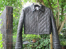 Moschino leather jacket . Black quilted , cropped, small to medium , worn once .