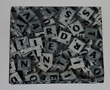 Fabric fat quarter with scrabble tiles in greys with black letters