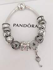 PANDORA HEART SHAPED BRACELET ,12 CHARMS IN GREAT  CONDITION, RARELY WEAR