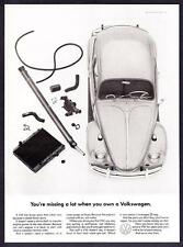 "1965 Volkswagen Beetle photo ""You're Missing a Lot Owning a VW"" promo print ad"
