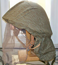Post WWII original EAST GERMAN M56 HELMET with liner rain pattern hood cover net