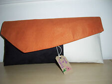 COLOUR BLOCK ORANGE, BLACK & CREAM faux suede clutch bag, fully lined.