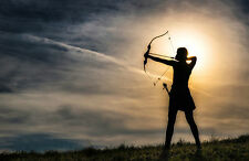 Framed Print - Archer Firing an Arrow at Sunset (Picture Archery Recurve Bow)