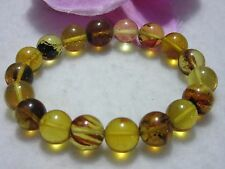 Ref.# 825-Dominican Blue-Green Amber Bracelet Beads about 10.5 mm spheres(11.9g)