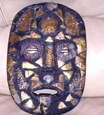 An old African hardwood tribal mask inlaid with beads, shells and brass VGC