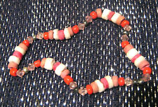 Fun elasticated bracelet made of plastic beadand coral beads