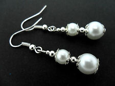 A PAIR OF WHITE  GLASS PEARL AND SILVER  PLATED DANGLY EARRINGS.
