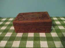 wooden carved box with red liner