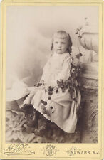 CABINET CARD, YOUNG GIRL WITH SLIGHTLY CROSSED EYES AND CURLS. NEWARK, NJ.