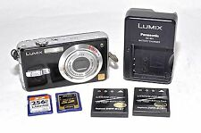 Panasonic Lumix DMC-FX7 Digital Camera Leica Lens, Batteries, Charger, SD Cards