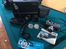 Yashica Electro 35 GSN Camera, Case, Flash, Extra Lenses and Manual.