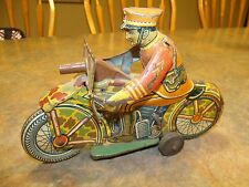 RARE EARLY VINTAGE LOUIS MARX TIN WINDUP TOY MOTORCYCLE WITH SOLDIER AND GUN