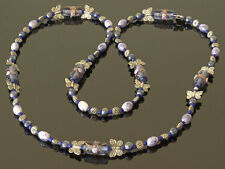 Exclusive, handmade necklace in soft and dark blue beads and Tibetan silver