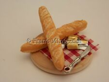 Dolls house food: Two French sticks  and butter board  -By Fran