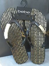 New w tags Bebe sandals, flip flops black w/gold band logo small  Size 6-6.5