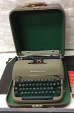 Vintage Remington Quiet-riter Portable Typewriter with Case, Manual, and Key