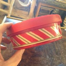 Red candy can striped plastic container