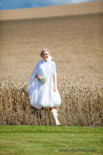 Brides wedding day waterproof rain cloak which holds your dress up from puddles