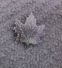 Vintage Silvertone Maple Leaf Pin With A Medal Attached To The Back