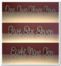 Set of 10 wooden freestanding table numbers written in words for wedding decor.