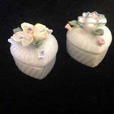 Pair of heart shaped porcelain trinket boxes, delicate raised flowers on lid