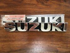 Suzuki GT550. GT380. GT250. GT185. insignias Tanque.
