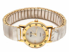 INFINITY:WOMEN'S STRETCH MOTHER OF PEARL BAND ROUND  ANALOG QUARTZ WATCH