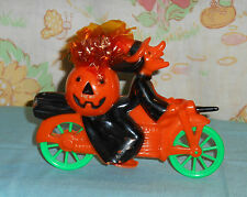 vintage Halloween WITCH RIDING BICYCLE bike candy holder container (with cello)