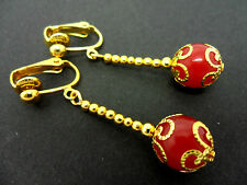 A PAIR OF DANGLY RED JADE  BEAD GOLD PLATED DROP CLIP ON EARRINGS.