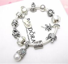 Authentic Pandora Silver Bangle Charm Bracelet With White Beach European Charms.
