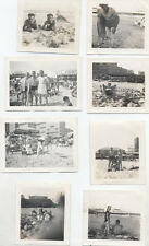 SET OF 8 PHOTOGRAPHS OF PEOPLE ON THE BEACH - 1940S ORIGINALS