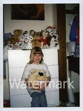 1990s Color Photo Young Girl with Plush toys dogs
