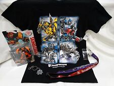 UNIVERSAL STUDIOS TRANSFORMERS SM T-SHIRT, AUTOBOT DRIFT TOY, KEYCHAIN, & LANYAR