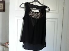 Black sleeveless lace front top with cowl back.
